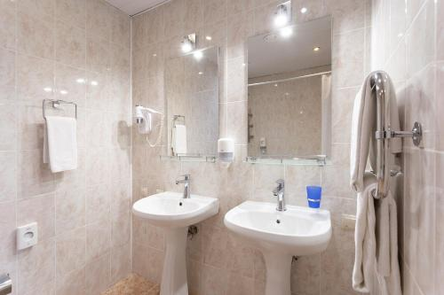 Ванная комната в Riders Lodge Роза Хутор