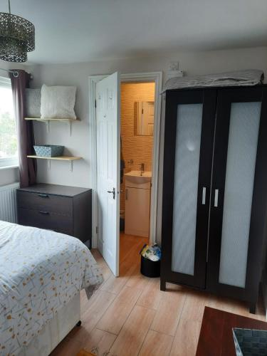 A bed or beds in a room at Catford Ardgowan