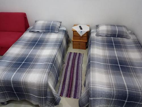 A bed or beds in a room at kitnet Maysa em Benfica RJ