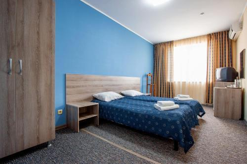 Кровать или кровати в номере Форум