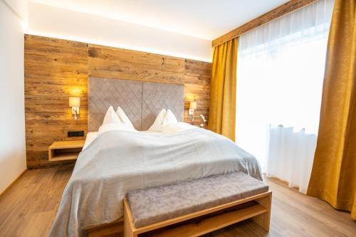 A bed or beds in a room at Apartment Bergsee