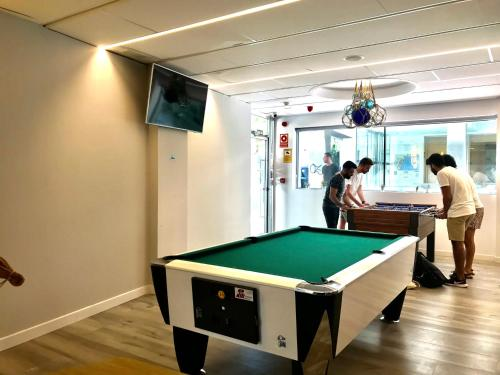A pool table at We Hostel Palma - Albergue Juvenil