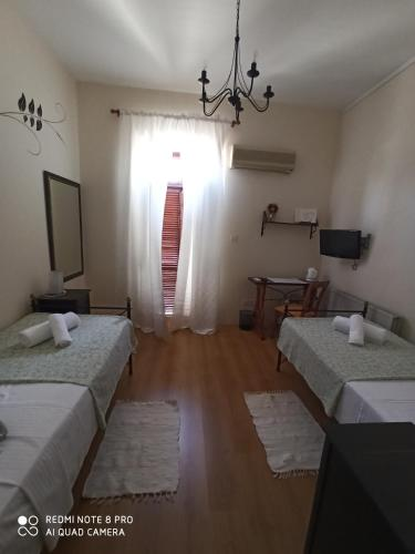 A bed or beds in a room at Lefkara Hotel