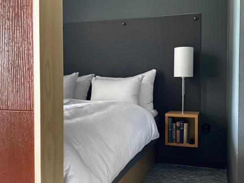 A bed or beds in a room at Mornington Hotel Bromma