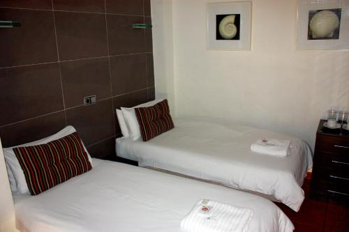 A bed or beds in a room at Casa Don Juan