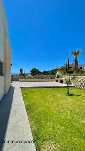 A garden outside Luxury Villa with magnificent view & pool