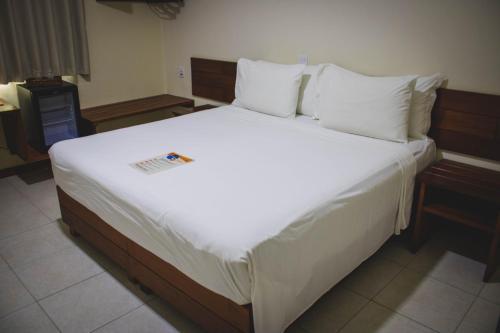 Cama ou camas em um quarto em Estância Avaré Hotel