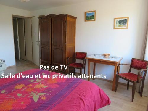 Un ou plusieurs lits dans un hébergement de l'établissement Ô prés d'ici Chambres d'hôtes