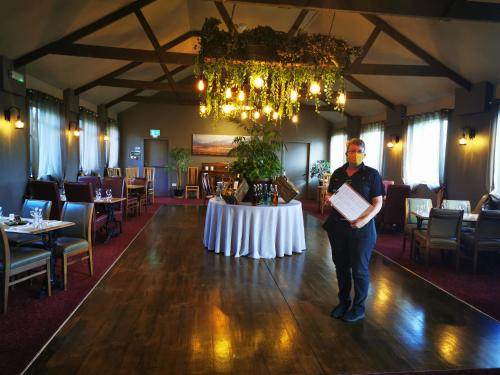 A restaurant or other place to eat at Black Bull Gartmore