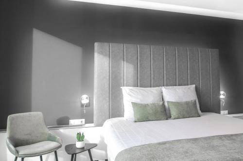 A bed or beds in a room at Select Hotel Maastricht