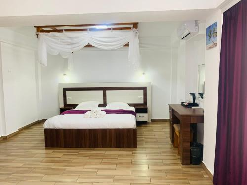 A bed or beds in a room at Casa Barina Costinești