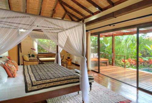 A bed or beds in a room at Nayara Springs - Adults Only