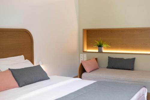 Letto o letti in una camera di Mandraki Village Boutique Hotel