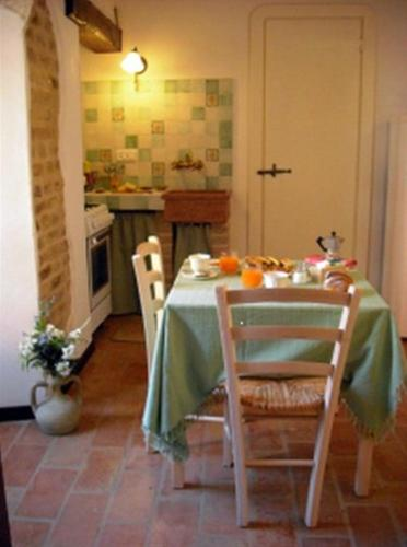 A restaurant or other place to eat at Apartment in Castelferretti/Marken 22761