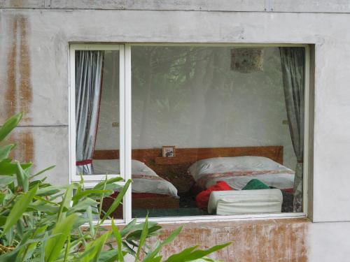 A bed or beds in a room at Wisdom Garden Home Stay