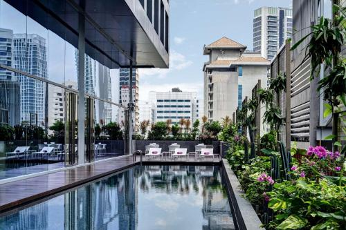 The swimming pool at or near YOTEL Singapore Orchard Road (SG Clean, Staycation Approved)