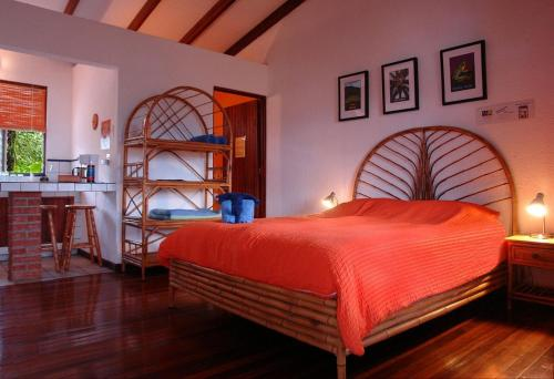 A bed or beds in a room at Orosi Lodge