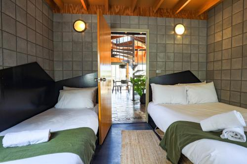 A bed or beds in a room at Grampians Getaway