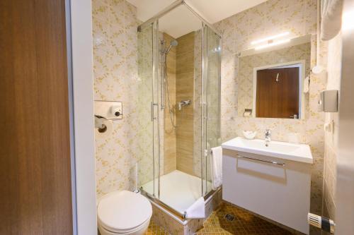 Ein Badezimmer in der Unterkunft Hotel Kaspar Garni