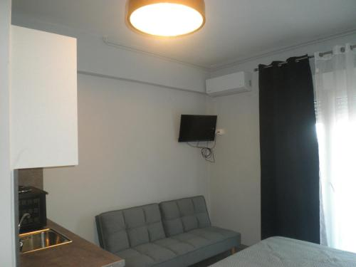A television and/or entertainment centre at Paralion Town Apartments