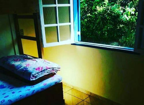 Cama ou camas em um quarto em Pousada Querência
