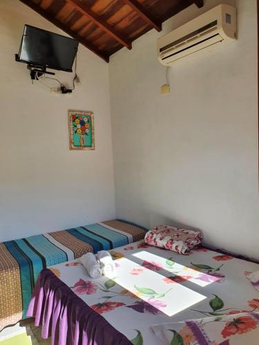 Cama ou camas em um quarto em Pousada Veromar