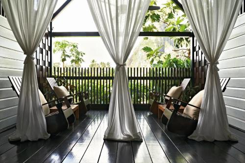 A balcony or terrace at Rabot Hotel From Hotel Chocolat
