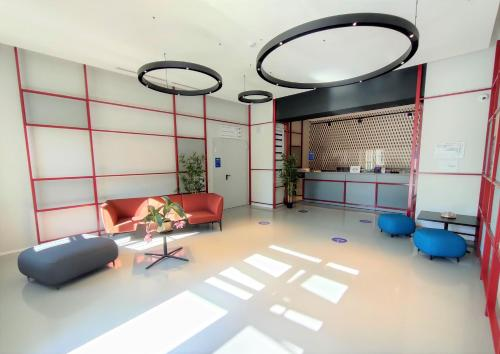The fitness center and/or fitness facilities at Camplus Guest Bernini Casa per Ferie