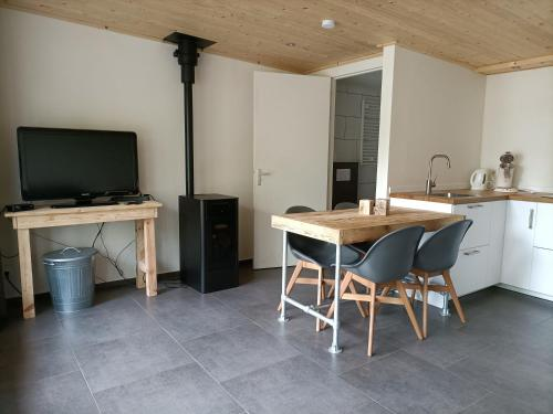 A television and/or entertainment center at Het Denneke