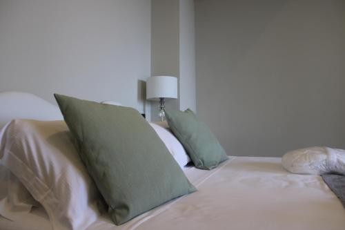 A bed or beds in a room at La Locanda Del Pontefice - Luxury Country House