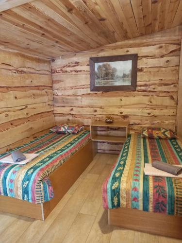 A bed or beds in a room at Kempings Vīnkalni
