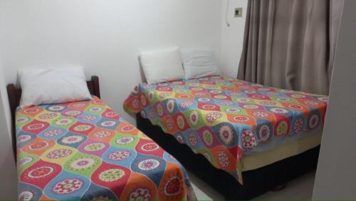 A bed or beds in a room at Apartamento Taperapuan