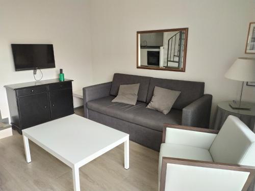 A seating area at Apartamentos Hg Cristian Sur