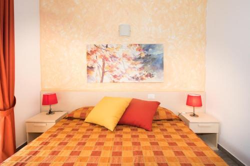 Letto o letti in una camera di Bed & Breakfast Camollia