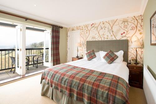 A bed or beds in a room at Holbeck Ghyll Country House Hotel