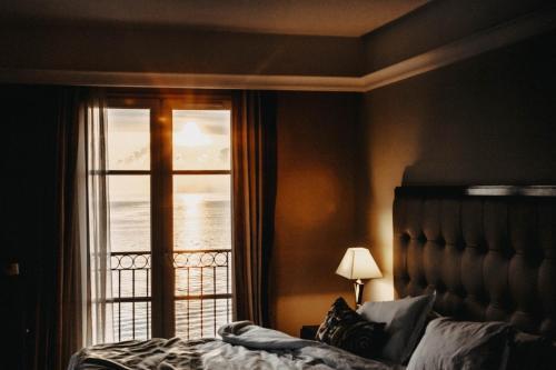 Un ou plusieurs lits dans un hébergement de l'établissement Hôtel Des Gouverneurs