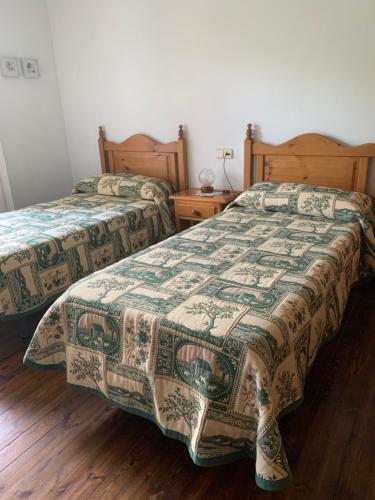 A bed or beds in a room at Casa planominguero