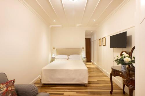 Un ou plusieurs lits dans un hébergement de l'établissement Despotiko Hotel