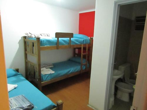 A bunk bed or bunk beds in a room at Hostel S & J Mendoza