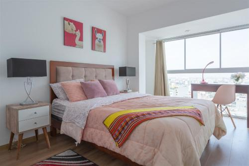 A bed or beds in a room at Exclusive Penthouse with Private Rooftop Jacuzzi by Simply Comfort
