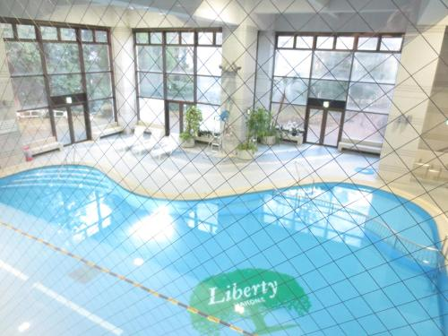 The swimming pool at or near Wisterian Life Club Verde no Mori