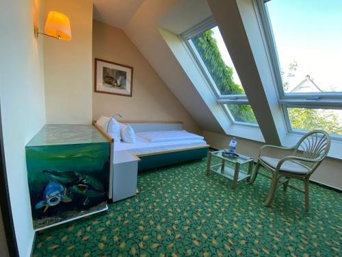Ein Bett oder Betten in einem Zimmer der Unterkunft Hotel am Müritz-Nationalpark
