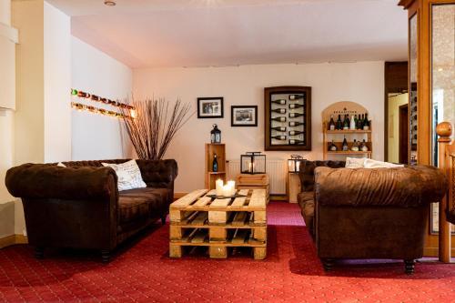 Ein Sitzbereich in der Unterkunft Hotel Eydt Kirchheim