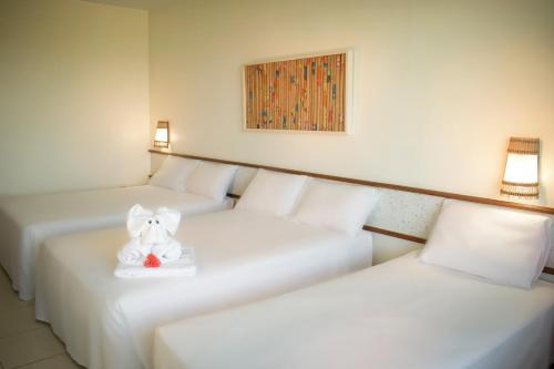A bed or beds in a room at Hotel Praia do Sol