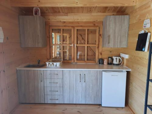 A kitchen or kitchenette at Cyprus Glamping Park