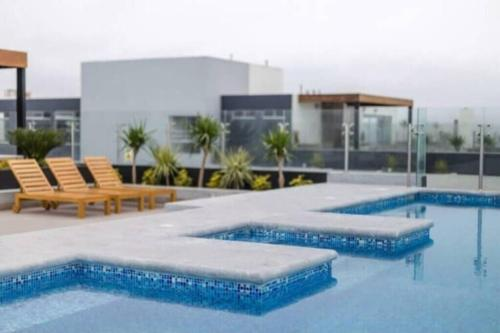 The swimming pool at or close to Apartment deluxe , con vista al mar, San Miguel