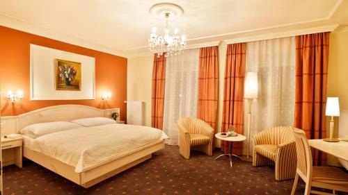 Ein Bett oder Betten in einem Zimmer der Unterkunft Hotel Stenitzer