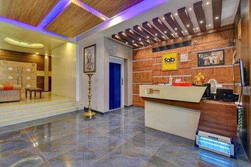 The lobby or reception area at FabHotel Golden Swan Airport