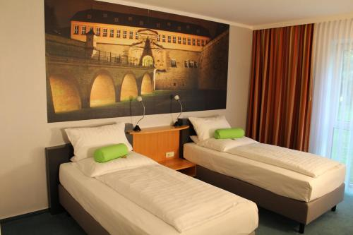 A bed or beds in a room at H+ Hotel Erfurt