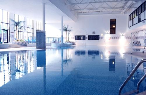 The swimming pool at or near Village Hotel Leeds North